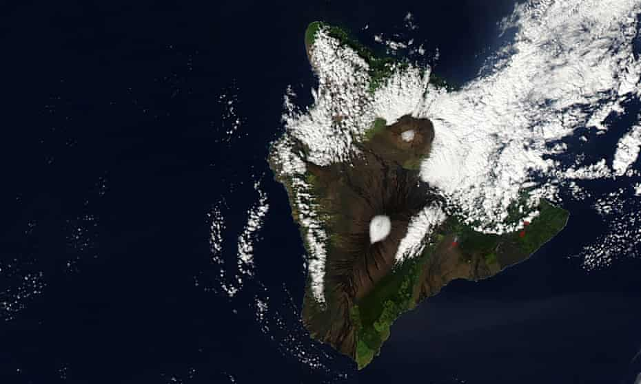 Unusual blizzard conditions turned some Hawaiian summits white with snow for Christmas day