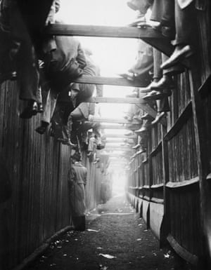 Spectators at The Den watch the action during the 2-2 draw between Millwall and Manchester City