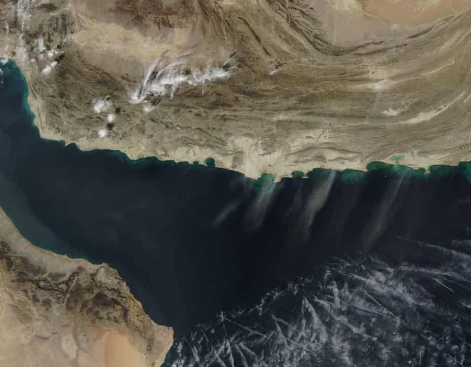 Streams of pale dust blow from Iran (in the northwest) and Pakistan (northeast) across the Arabian Sea