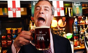 Nigel Farage celebrates with a pint in  2014.