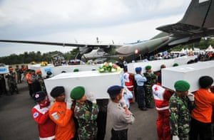 Iskandar, Malaysia Joint officers carry the coffins that contain victims of AirAsia flight QZ8501 to the aircraft that brings them to Surabaya at Iskandar Air Base
