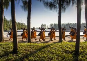 Monks leave the meditation hall at Wat Phra Dhammakaya to start the 4th annual Dhammachai Dhutanaga Buddhist monks start mass pilgrimage, Khlong Luang