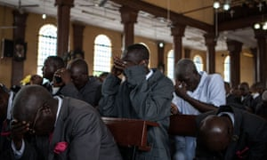 Men pray for victims of the Ebola virus in St Anthony's Catholic church in Freetown