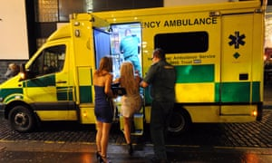 A woman is led into an ambulance in Concert Square, Liverpool, in the early hours of New Year's Day.