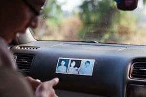 Photographs of opposition leader Aung San Suu Kyi on a car dashboard, Burma