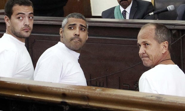 Baher Mohamed, Mohamed Fahmy and Peter Greste in court in Cairo