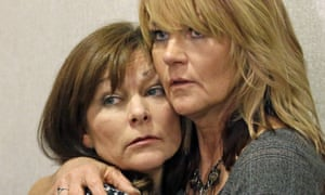 Susan Hunt, left, the mother of Darrien Hunt, is hugged by her sister, Cynthia Moss.