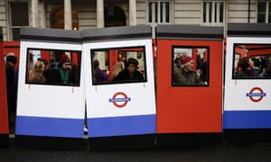 People carry parts of a wooden Underground Tube train for London New Year's Day Parade.