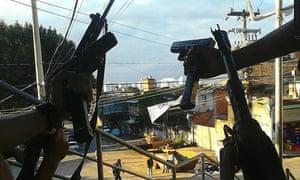 Keeping watch on a street in Vila Aliança.