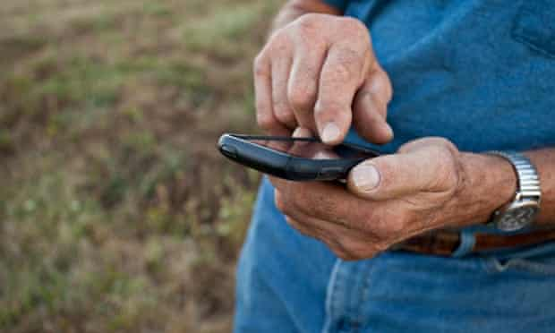 Close up of older man using cell phone