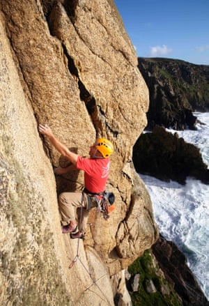 British mountain guide Steve Monks climbing the granite cliffs at Bosigran, West Penwith, Cornwall, UK