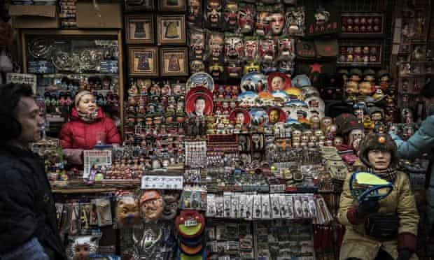 Chinese vendors wait for customers at a market in central Beijing