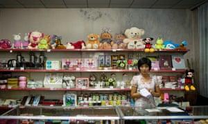 A North Korean woman works as a shopkeeper in Pyongyang.