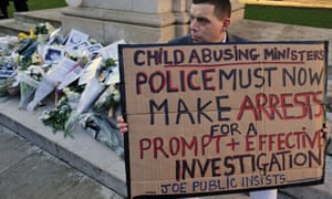Josh Blakely, 35, who claims he was a victim of child abuse whilst living in a care home, holds a banner at Old Palace Yard in Westminster, during an event organised by the WhiteFlowers Campaign Group, in commemoration of victims and survivors of child abuse.