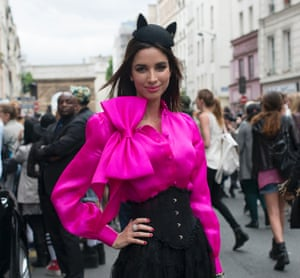Kate Spade, the designer of this billowy shirt on fashion blogger Mellissa Melita, may see sales suffer from a stronger dollar, analysts said.