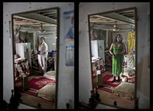 Amjad Mahmoud, 44, reflected in a mirror at his home