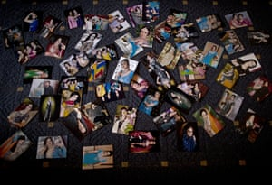 Pictures of transgender people are spread on the ground of an apartment