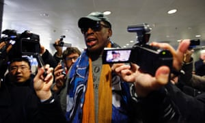 Former NBA basketball player Dennis Rodman talks to media at Beijing International Airport in 2013 before leaving for Pyongyang. He said he would not talk about politics or human rights in the country.