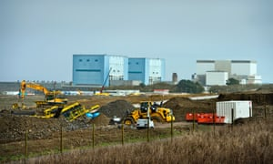 Visit to the Hinkley Point B nuclear power station and the Hinkley Point C construction site in Somerset on 7 Nov 2014.  Earthworks in preparation for the construction of EDF Energy's Hinkley Point C nuclear power station (twin reactors of Hinkley A in the background, and Hinkley B, right).