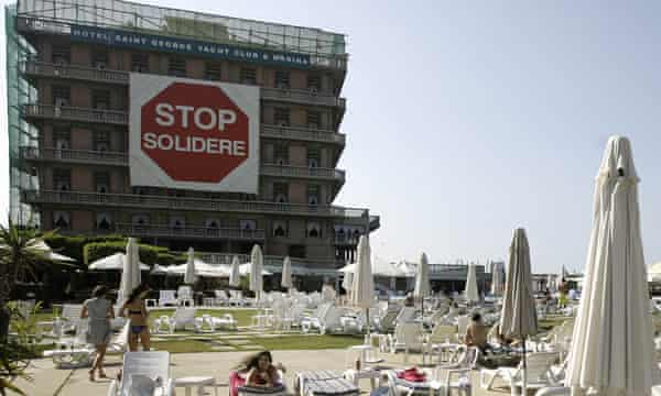 A massive billboard reading 'Stop Solidere', in reference to the construction giant owned by the family of slain former Lebanese premier Rafiq Hariri, hangs at the Saint Georges Hotel and Yacht Club in Beirut. Once a symbol of Beirut's golden age, the St Georges hotel today is but a hollow shell at the centre of an epic real estate battle pitting its owner against powerful developers.