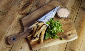 Whitebait served in a cone of newspaper with a small dish of pink Marie Rose sauce by the side