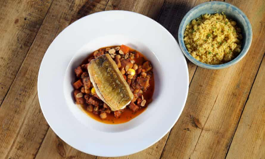 Fillet of gurnard on a bright ratatouille with a dish of cous cous by the side
