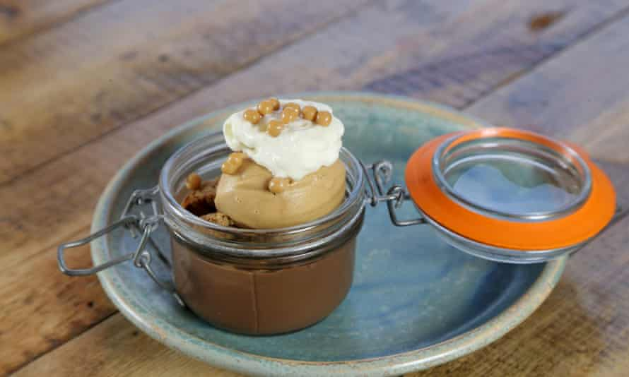 Chocolate pot: a glass jar of milk chocolate ganache with salted-caramel ice cream on top and aerated cream on top of that