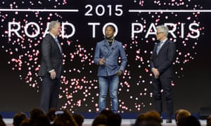Former US Vice President Al Gore (L) and Live Earth founder Kevin Wall (R) listen to US singer Pharrell Williams during a session of the World Economic Forum (WEF) annual meeting on January 21, 2014 in Davos.