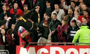 0116f5656 Eric Cantona kicks Crystal Palace fan Matthew Simmons after being sent off  at Selhurst Park on 25 January 1995. Photograph  Action Images. ""