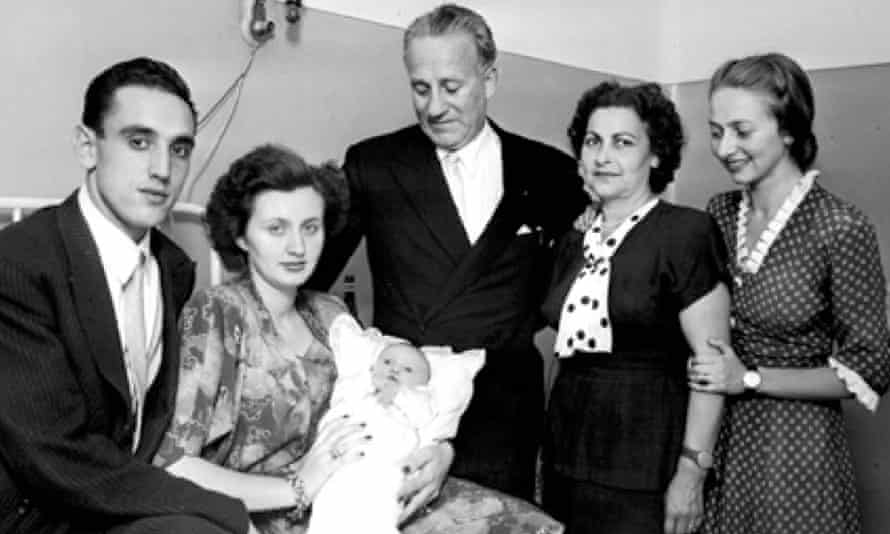 Ernö Erbstein, centre, with wife Jolanda to his right and daughter Susanna far right after the birth of the son of the Torino player Iosif Fabian.