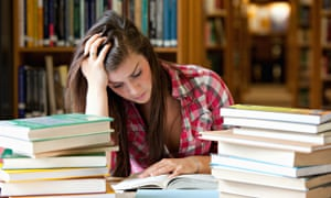 Female student surrounded by books