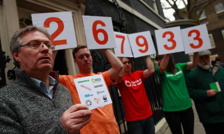 After delivering a 267 933 strong petition urging the Prime Minister to reconsider his    all-out  support for fracking, a group of David Cameron's constituents and environmental campaigners stand outside the entrance to No10 holding placards spelling out the number of people who signed it on 21 January 2015.