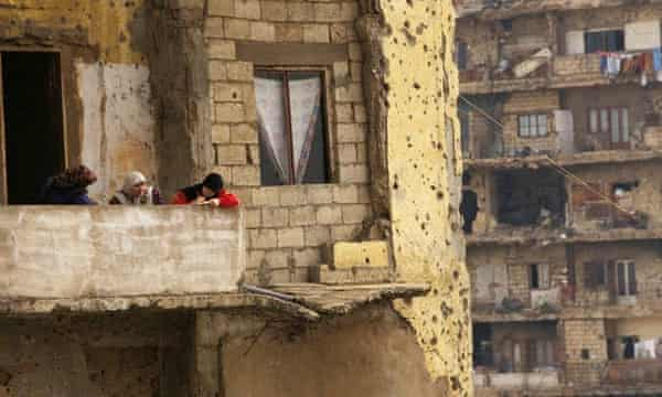 Squatters living in the ruins of buildings along Beirut's former Green Line in 1996.