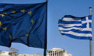 Greek and EU flags fly in front of the Parthenon in Athens.