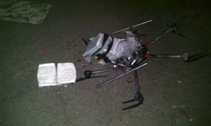 Image from Tijuana municipal police of the drone, loaded with packages containing methamphetamine.