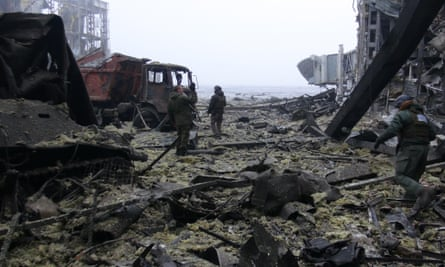Rebel soldiers clear debris in the destroyed Donetsk airport.