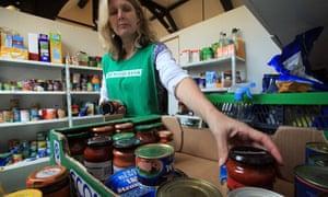 A Salisbury food bank volunteer sorts a donation of food.