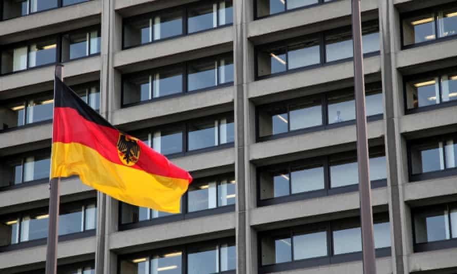A German flag flies in front of the Bundesbank headquarters in Frankfurt.