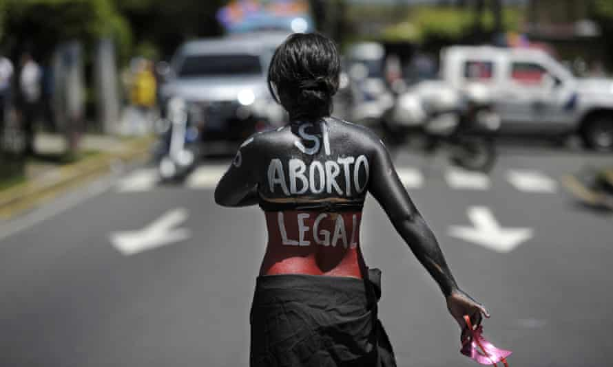 A woman participates in a march in San Salvador on the international day of action for the decriminalisation of abortion.