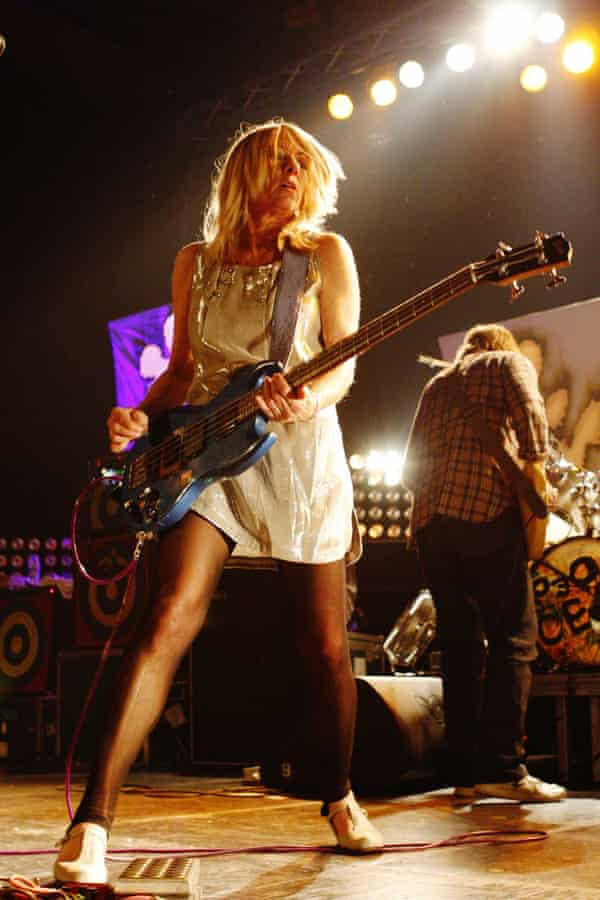 Kim Gordon on stage with Sonic Youth in 2009. Her ex-husband Thurston Moore is also pictured, facing away from the camera.