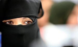 A young Muslim woman wearing the burka