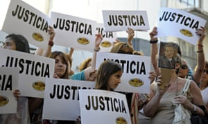 """People hold placards that read """"Justice"""""""