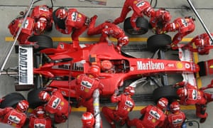 A Ferrari at a pit stop during the 2004 Malaysian Grand Prix. Tobacco sponsorship of global sports such as Formula One was banned in 2005