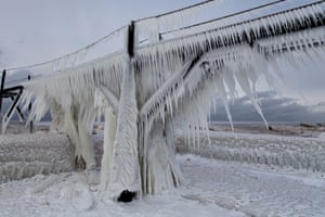 Ice hangs from the railings at St Joseph Lighthouse. Sharp icicles and surreal formations can be seen sticking out from the railings after strong waves crashed on to the piers. Weather in the area dipped into the minus figures and Lake Michigan froze over at the beginning of January
