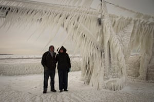 Mike and Pam Kline stand under the buildup of ice at St Joseph's lighthouse
