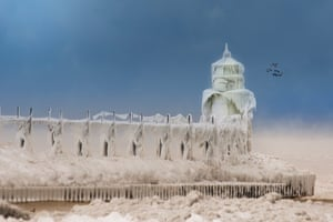 The front light at St Joseph Lighthouse. After each coating the water quickly freezes and the pier is transformed into a slippery, white wonderland
