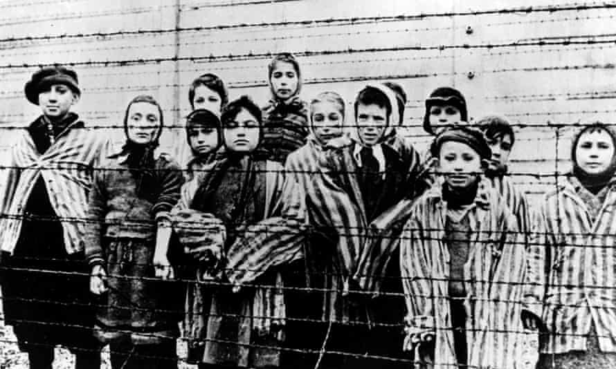 Children wearing concentration camp uniforms shortly after the liberation of Auschwitz by the Soviet army on 27 January 1945.