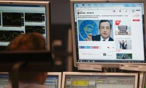 A trader in Frankfurt watches Draghi. Photo: Reuters/Ralph Orlowski.