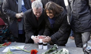 Mayor of New York Bill de Blasio and Mayor of Paris Anne Hidalgo (R) lay a candle next to the offices of French satirical weekly Charlie Hebdo on January 20, 2015, in Paris, France.