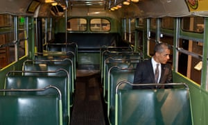 Barack Obama sits on the Rosa Parks bus at the Henry Ford Museum.
